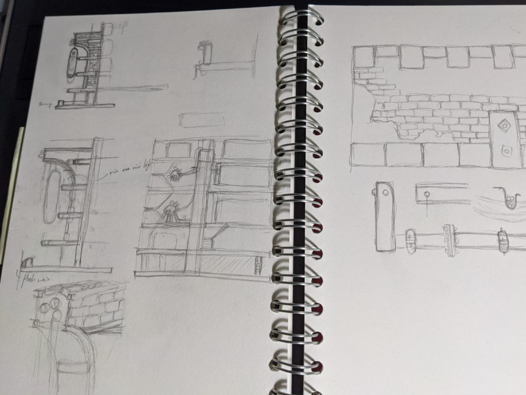 Notebook of ideas with various concepts sketched out for the board.